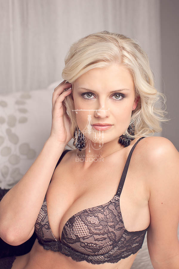 blonde bombshell in lace lingerie boudoir photo