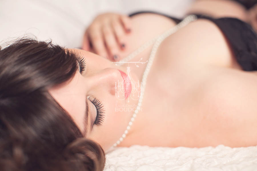 woman pearls and long lashes boudoir picture