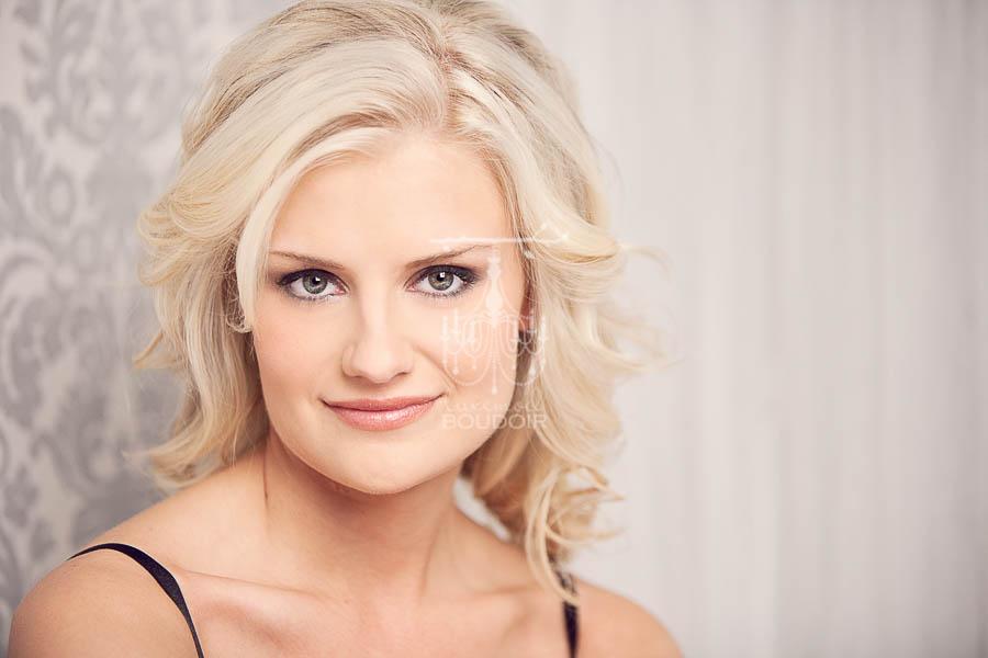 gorgeous blonde boudoir picture head shot