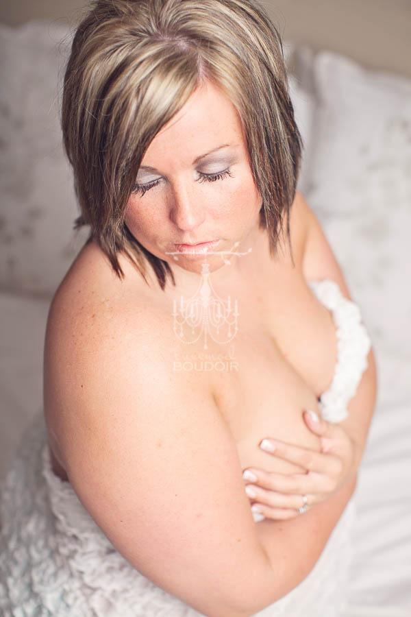 plus size boudoir portrait implied nude with short hair