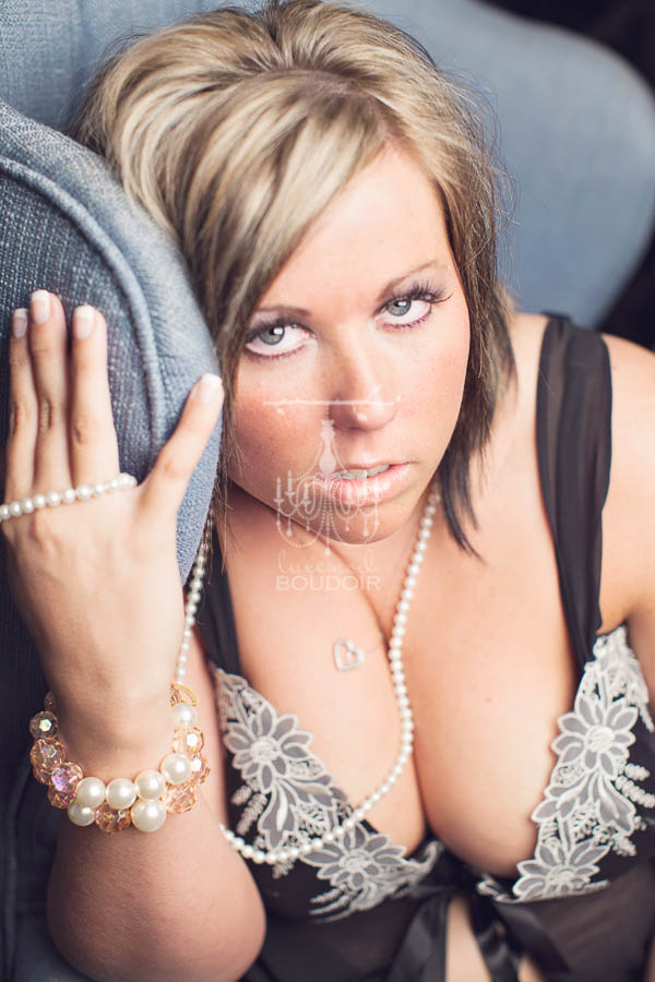 curvy woman with intense eyes boudoir portrait