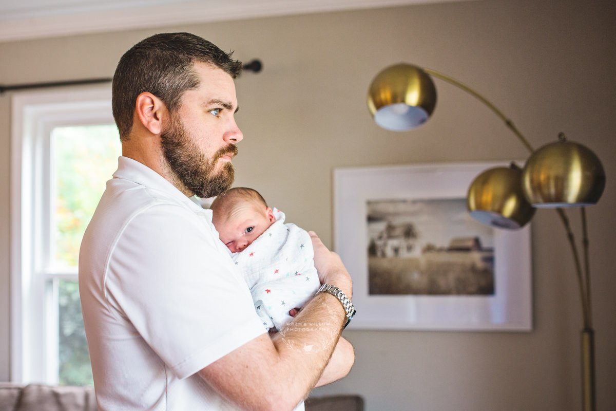 dad son lifestyle newborn photo