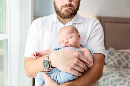 dad baby photo in nursery